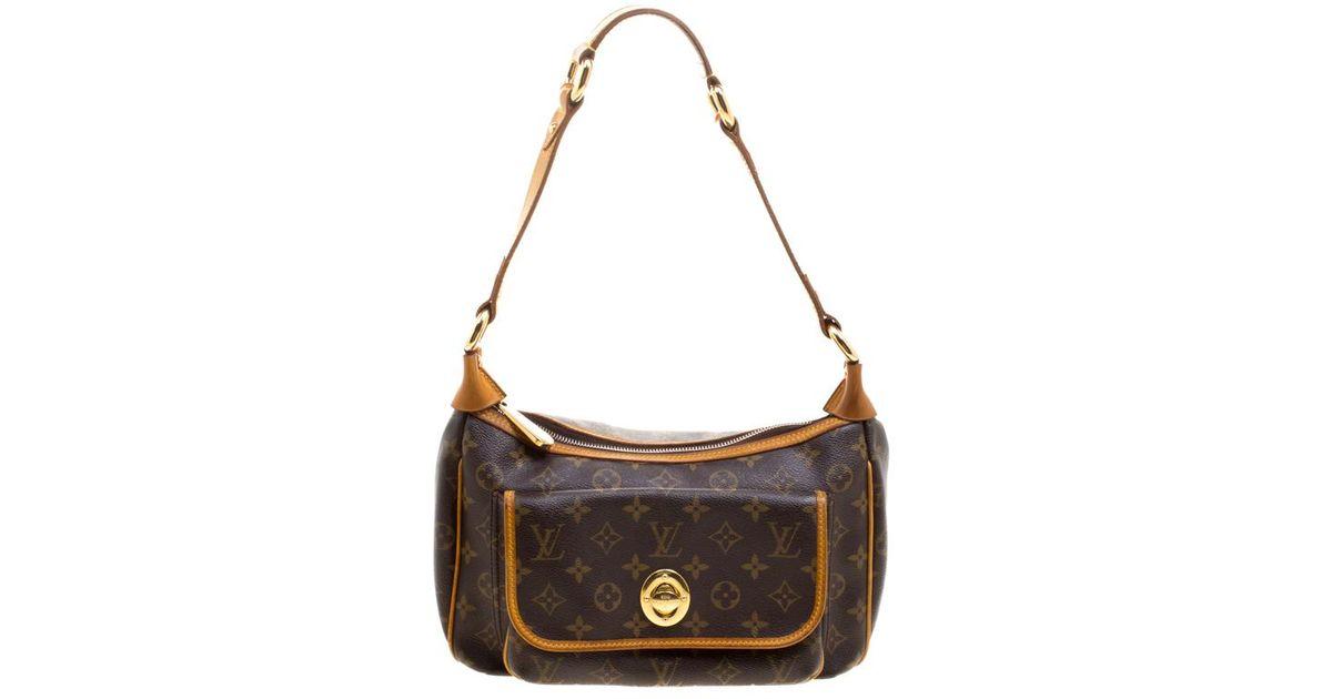9cc1b0df28cc Lyst - Louis Vuitton Monogram Canvas Tikal Gm Bag in Brown