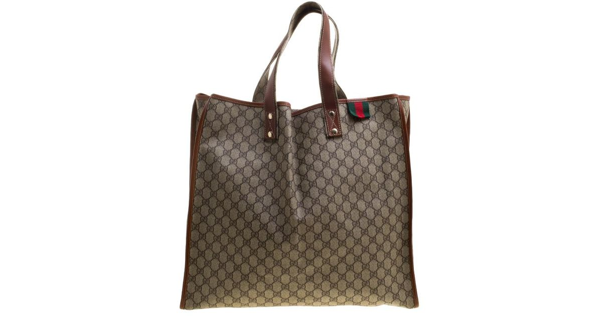7c717670cf67 Gucci /brown Gg Supreme Canvas And Leather Vertical Web Loop Tote in  Natural - Lyst