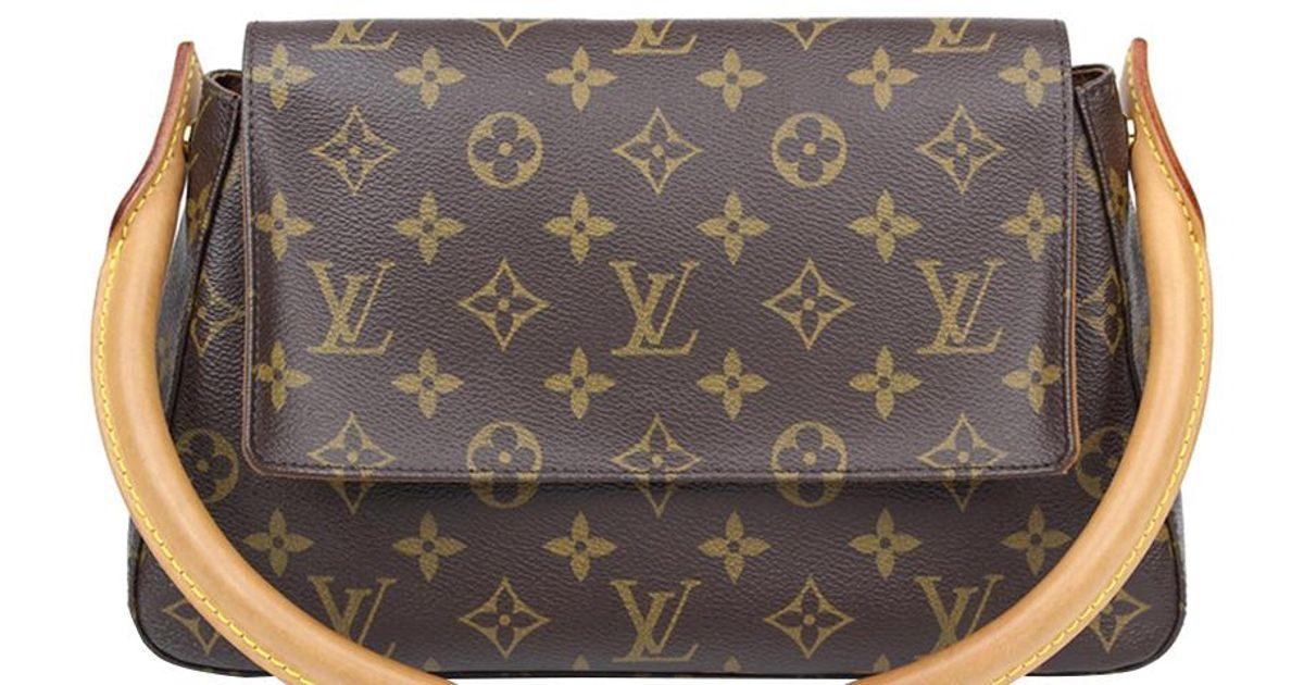 c9e79b8b36df Lyst - Louis Vuitton Monogram Canvas Mini Looping Bag in Brown