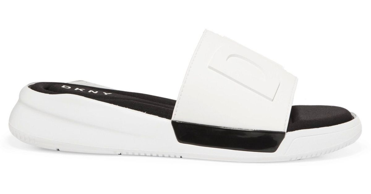 5851a2533a71e DKNY Embossed Rubber Sandals in White - Lyst