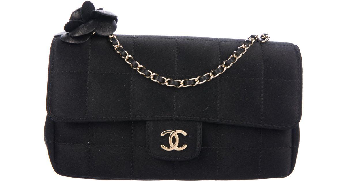 55932ee320a5 Lyst - Chanel Satin Camellia Flap Bag Black in Metallic