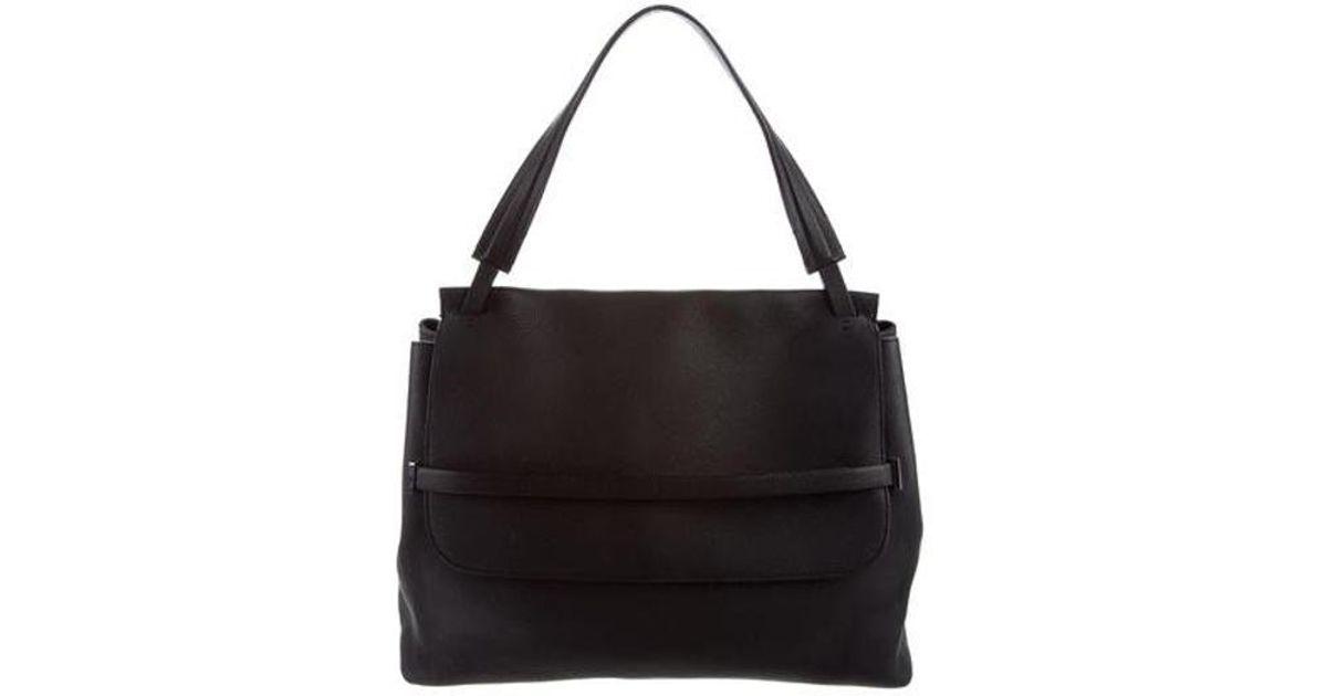 f2f302e6ccf0 Lyst - The Row Sidekick Leather Bag Black in Metallic