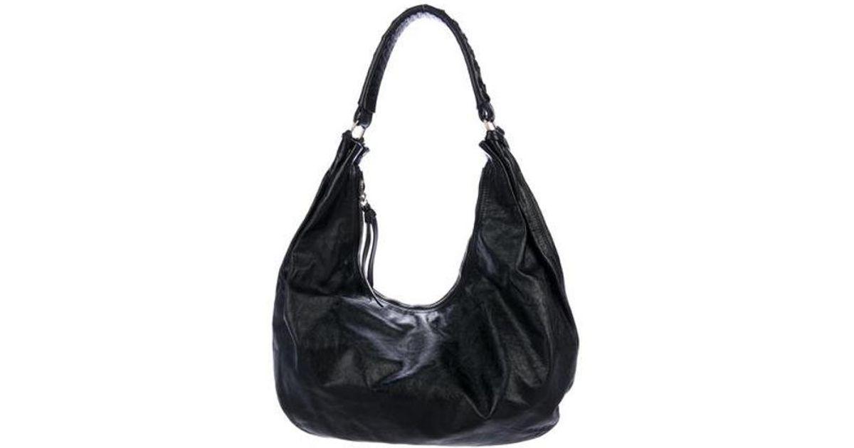 Lyst - Miu Miu Miu Distressed Leather Hobo Black in Metallic 79250aabe746c