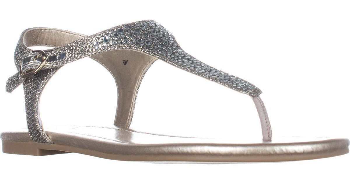 94a553dbcaee3e Lyst - Bandolino Kyrie T-strap Flat Sandals in Metallic