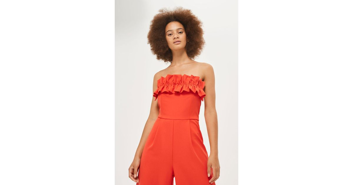 6650acda797 TOPSHOP Ruffle Bandeau Jumpsuit in Red - Lyst