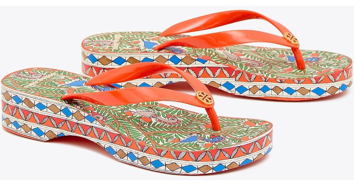 aa348f37660ead Tory Burch Printed Carved Wedge Flip-flop in Orange - Save 23% - Lyst