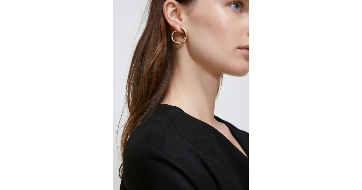 chesnais com pin caracol earring matchesfashion gold earrings charlotte plated