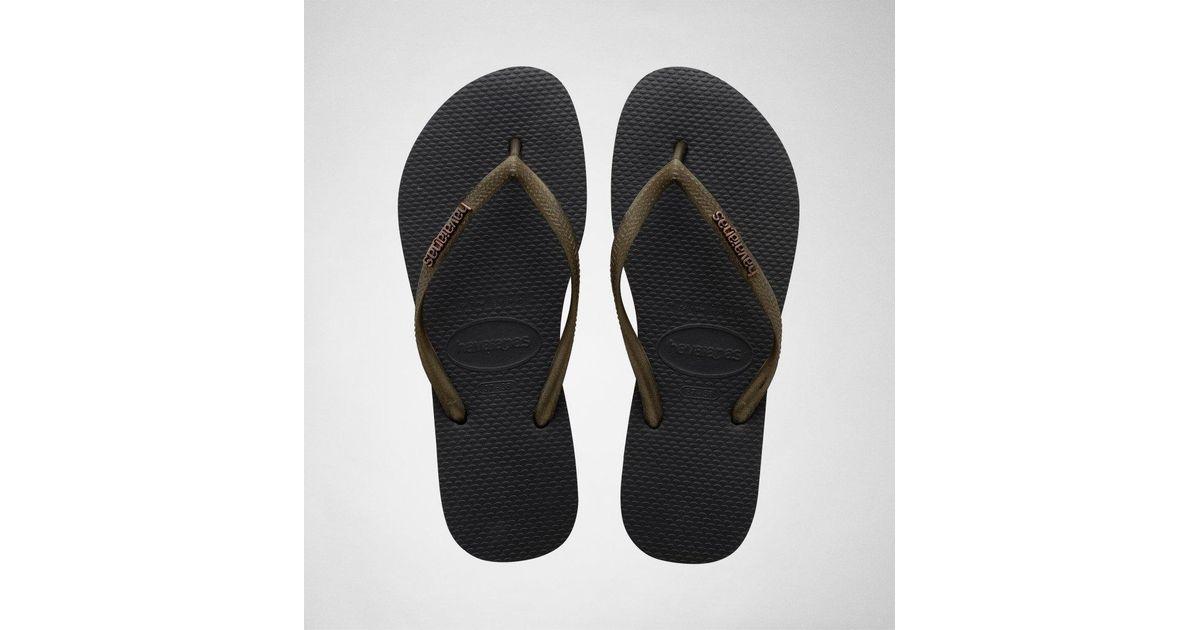 4afee43e828c Havaianas H.slim Logo Met Blk-gold Flip Flops in Black - Lyst