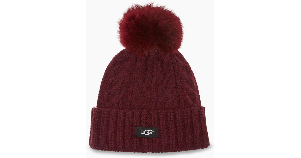 63643fe9768 UGG Women s Cable Pom Beanie in Red - Lyst