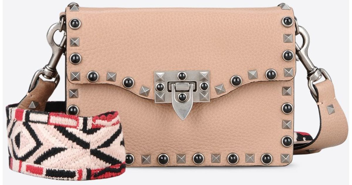 valentino guitar rockstud rolling small leather cross body bag in pink lyst. Black Bedroom Furniture Sets. Home Design Ideas