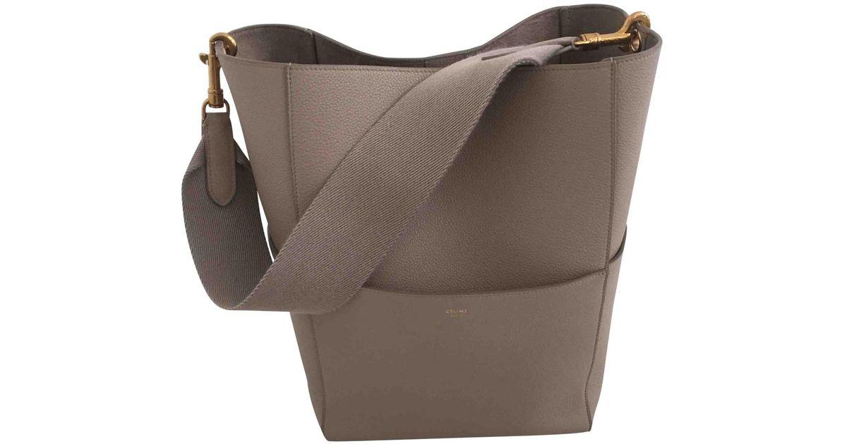Lyst - Céline Pre-owned Seau Sangle Leather Handbag in Gray 6cbb7814368a7