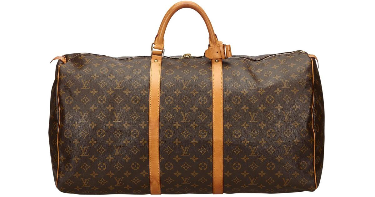 7f43fb2afbb2 Lyst - Louis Vuitton Pre-owned Keepall Cloth 48h Bag in Brown