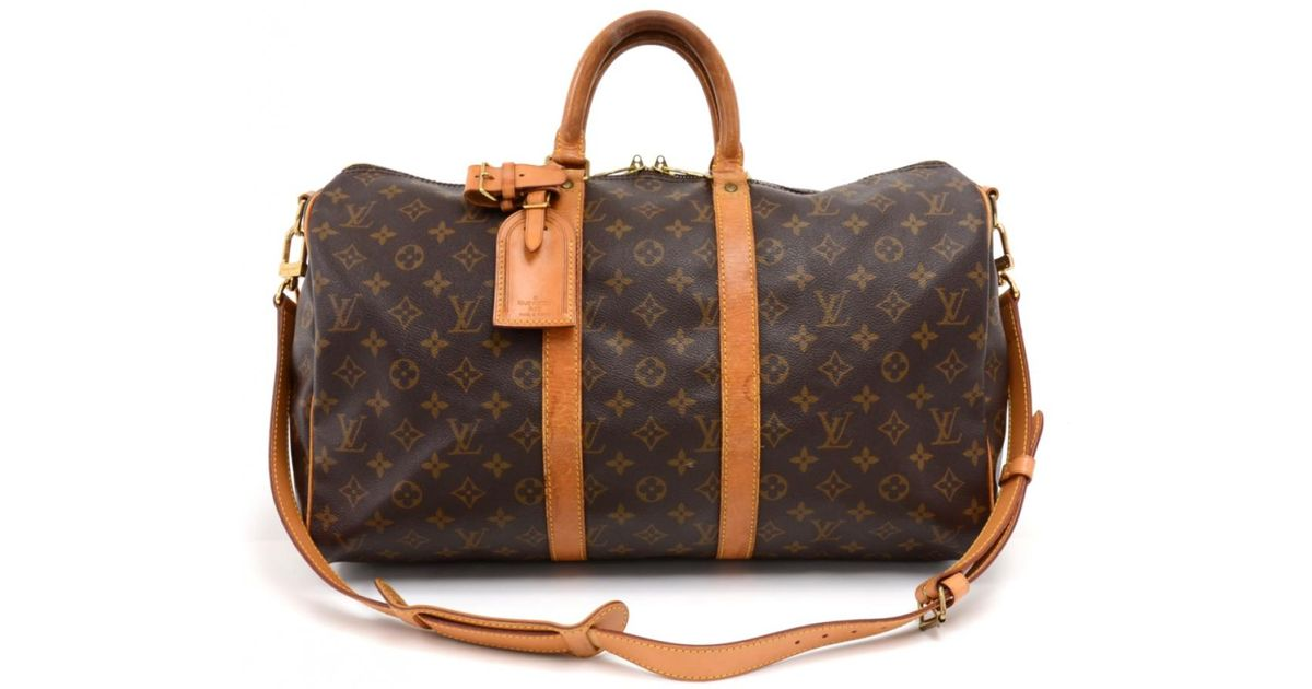 d4d7df448866 Lyst - Louis Vuitton Vintage Keepall Brown Cloth Travel Bag in Brown