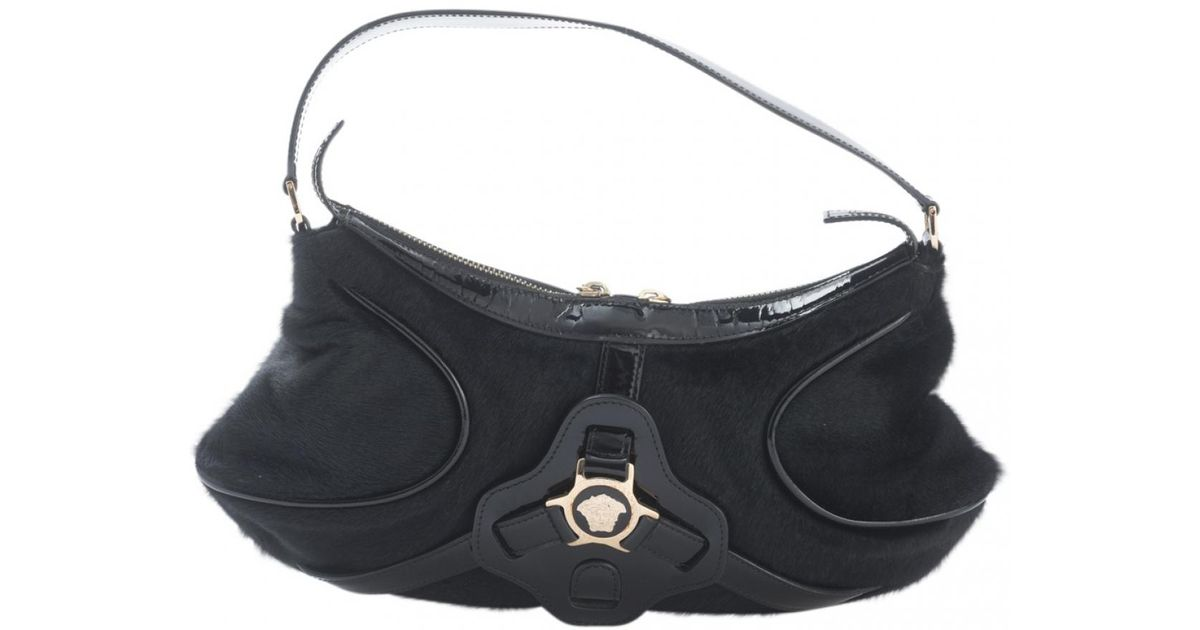 5b335b33a431 Lyst - Versace Black Pony-style Calfskin Handbag in Black