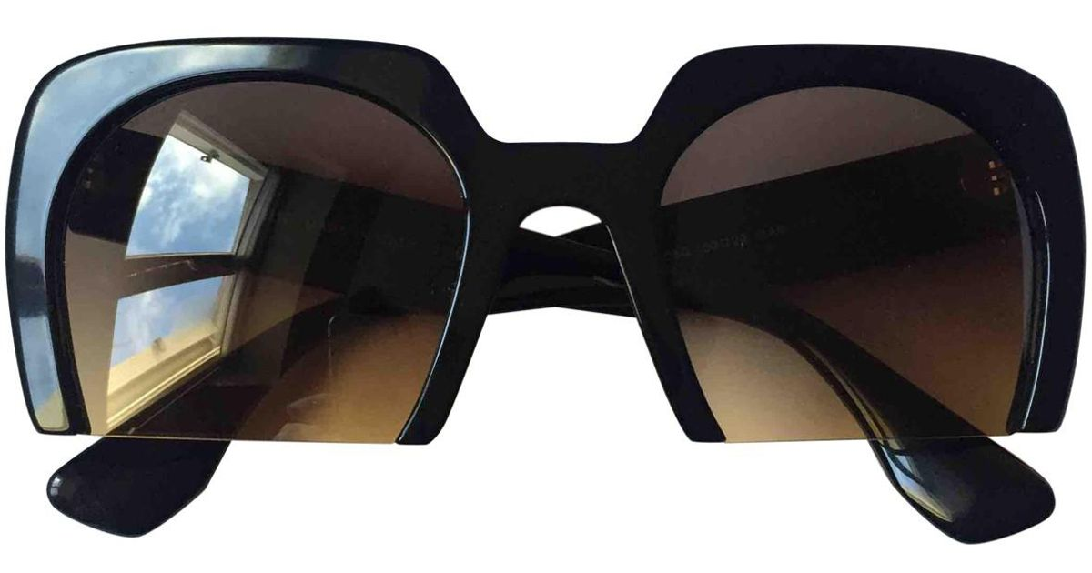 e435efc02c73 Lyst - Miu Miu Sunglasses in Black