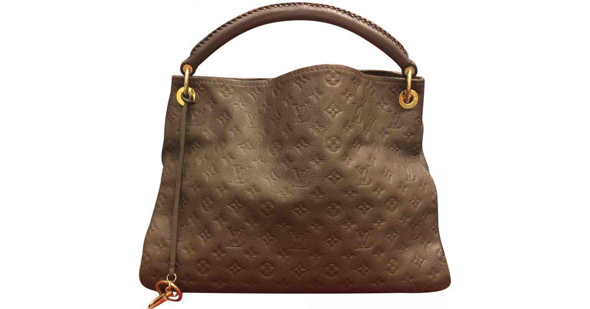6f1e4f63e33d Louis Vuitton Artsy Leather Handbag in Brown - Lyst