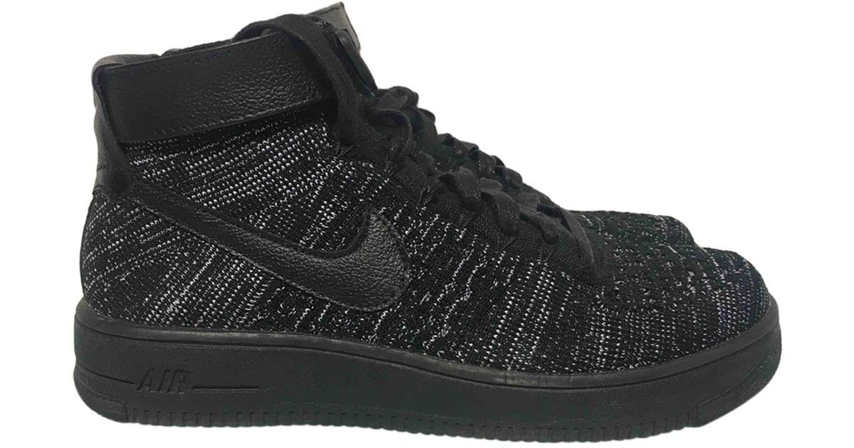 premium selection 18968 95f85 Nike Pre-owned Air Force 1 Black Cloth Trainers in Black - Lyst