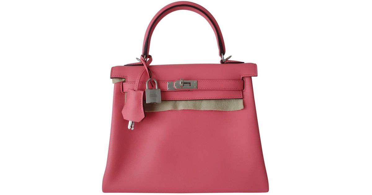 fb7bf85f35d5 Lyst - Hermès Kelly 25 Leather Handbag in Pink