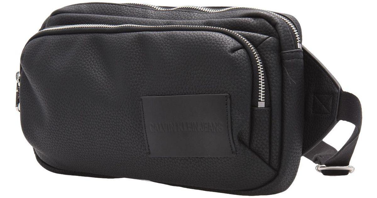 1bd7d801906e Calvin Klein Backpacks   Bum Bags in Black - Lyst