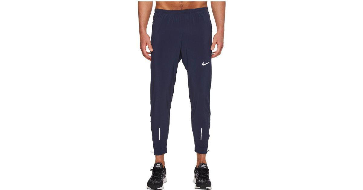 9a99b6ec1b080 Nike Flex Essential Running Pant in Blue for Men - Lyst
