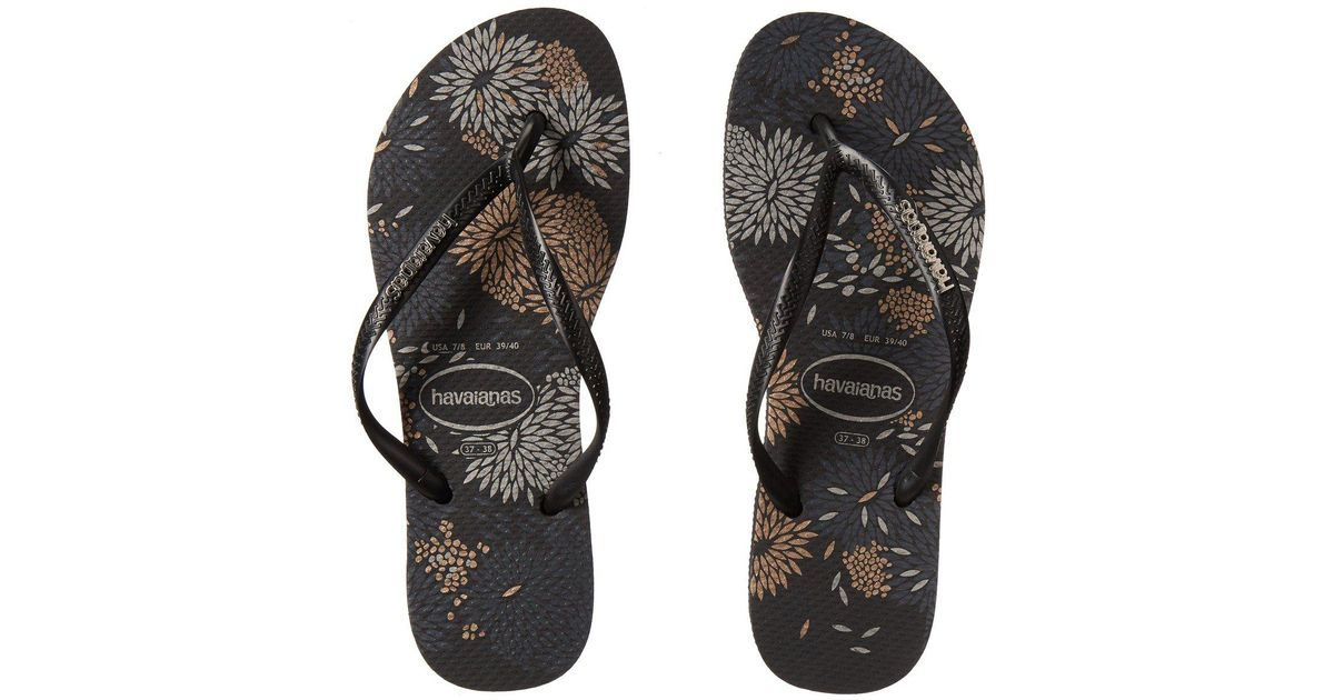 c4425f5d7 Lyst - Havaianas Slim Logo Metallic Bloom Flip Flops (black silver) Women s  Sandals in Black