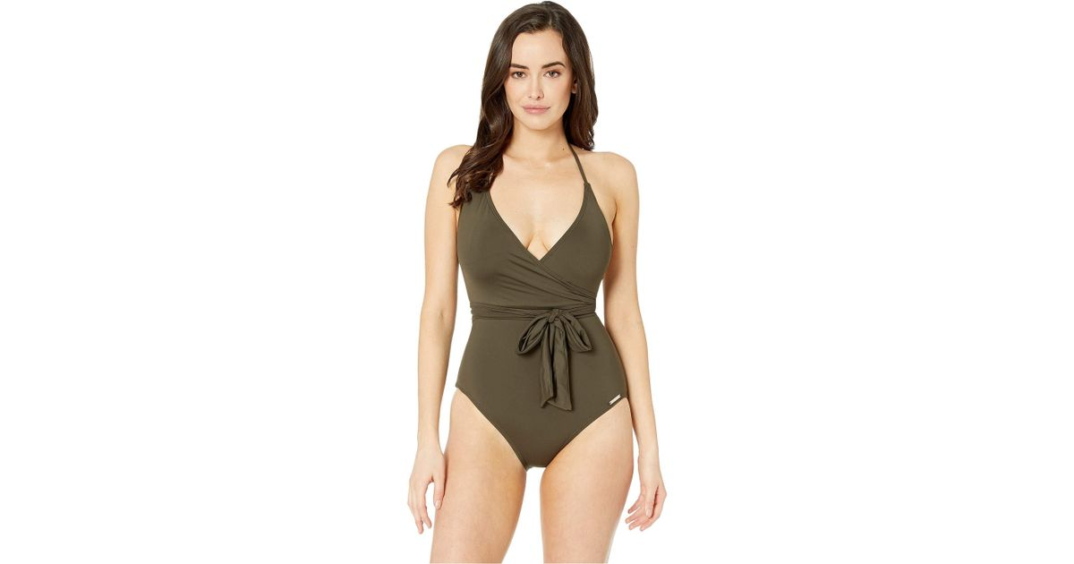 31cdde1468a Vince Camuto Surf Shades V-neck Wrap Tie One-piece (sand) Women's Swimsuits  One Piece in Green - Lyst