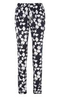 Diane Von Furstenberg Benett Orchidprint Silk Tapered Pants - Lyst