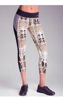 Bebe Print Colorblock Crop Pants - Lyst