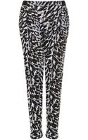 Topshop Speckle Leopard Jersey Tapered Trousers - Lyst