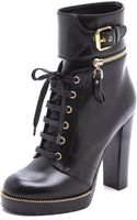 Sergio Rossi Leather and Rubber Heeled Booties - Lyst
