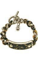 Michael Kors Twisted Plaque Bracelet Golden - Lyst