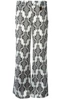 Thomas Wylde Printed Flared Trousers - Lyst