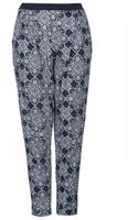 Topshop Star Tile Jersey Tapered Trousers  - Lyst