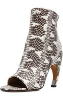 Givenchy Eclisi Curved Heel Snake Booties - Lyst