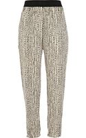 River Island Cream Print Soft Tapered Trousers - Lyst
