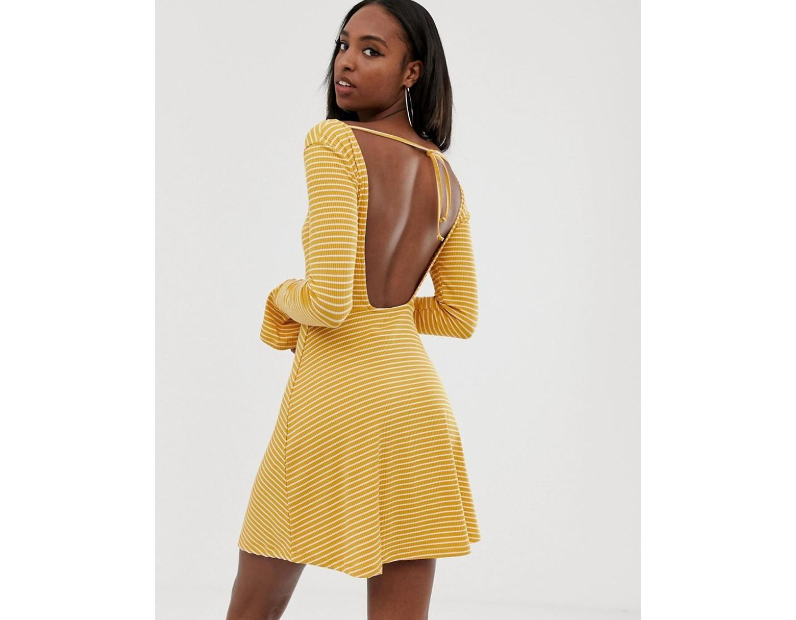 d723b4c73f6 ASOS Asos Design Tall Open Back Mini Skater Dress With Faux Tortoiseshell  Detail In Rib Stripe in Yellow - Lyst