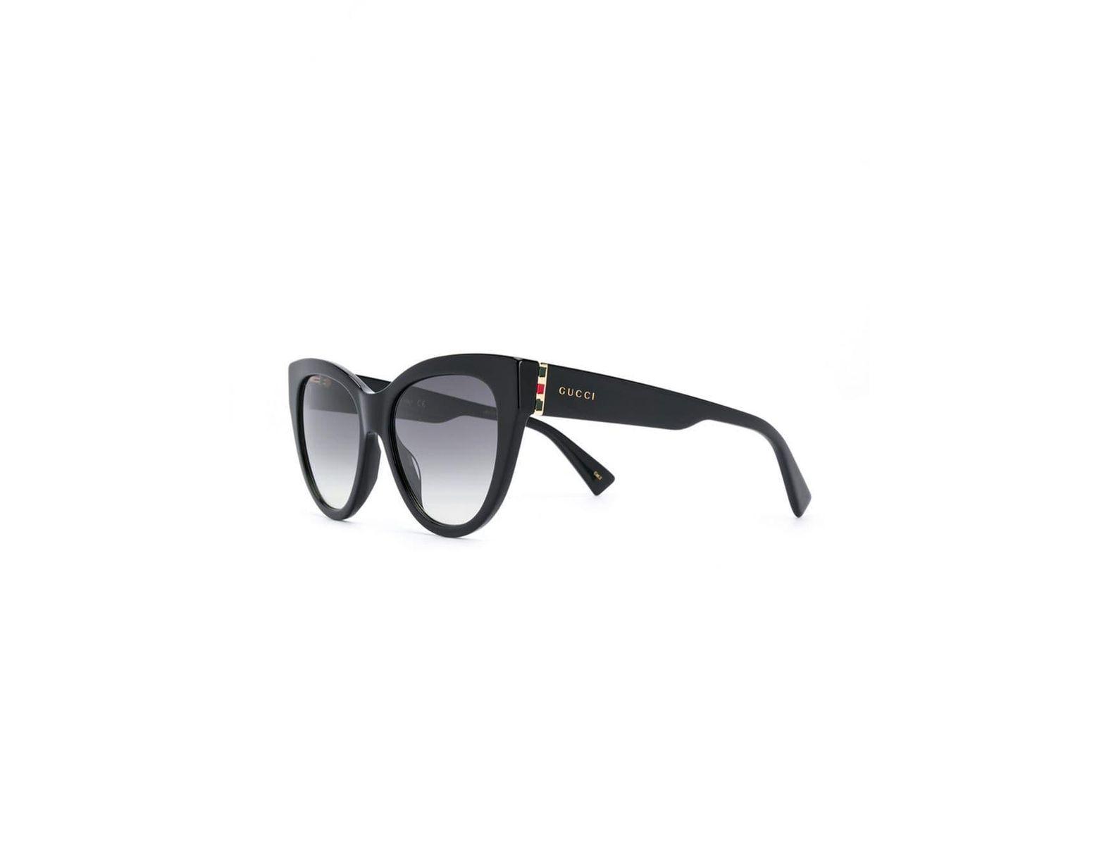 7712c18bc9 Gafas de sol estilo cat eye tintadas Gucci de color Negro - Lyst