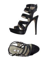 BCBGeneration - Black Sandals - Lyst