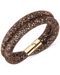 Swarovski | Metallic Gold-tone Stardust Wrap Bracelet | Lyst
