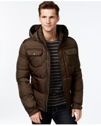 Levi's - Green Hooded Puffy Jacket for Men - Lyst