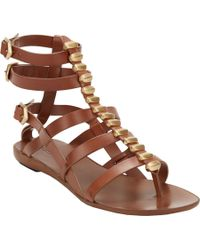 9570dbae4d7 Sartore Studded Flat Gladiator Sandals in Brown - Lyst
