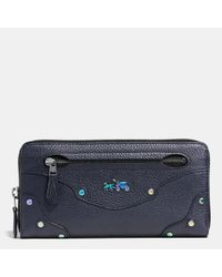 COACH | Blue Rhyder Accordion Zip Wallet In Oil Slick Rivets Leather | Lyst