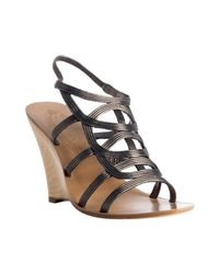 Elie Tahari | Black Old Gold Leather Carmella Wedge Sandals | Lyst