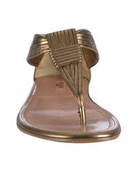 Alaïa - Metallic Bronze Leather Thong Flat Sandals - Lyst
