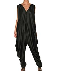 Saint Laurent | Black Fluid Shiny Silk Jersey Jumpsuit | Lyst