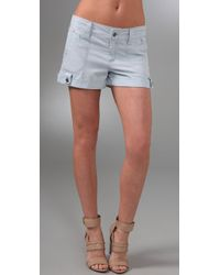 Alice + Olivia | Light Blue Cotton Blend Button Tab Cuff Shorts | Lyst