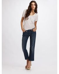 7 For All Mankind | Blue Cropped Flare Jeans | Lyst