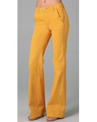 Tory Burch | Yellow High Rise Flare Pants | Lyst