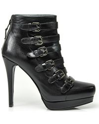 Stuart Weitzman | Iron Lady - Black Leather Buckled Bootie | Lyst