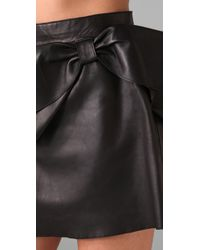 RED Valentino - Black Short Leather Skirt with Bow - Lyst